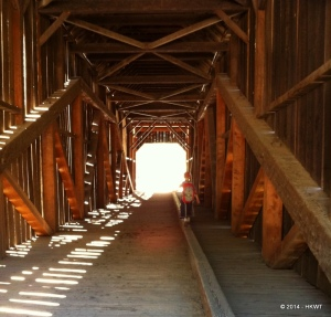 Making his way through the covered bridge