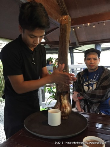 The Philippines has a very special hot cocoa they make. They make it by hand at this restaurant and this is the demonstration on how it is done.