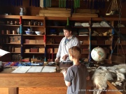 Finn working on his bartering skills in the Indian Trade Shop